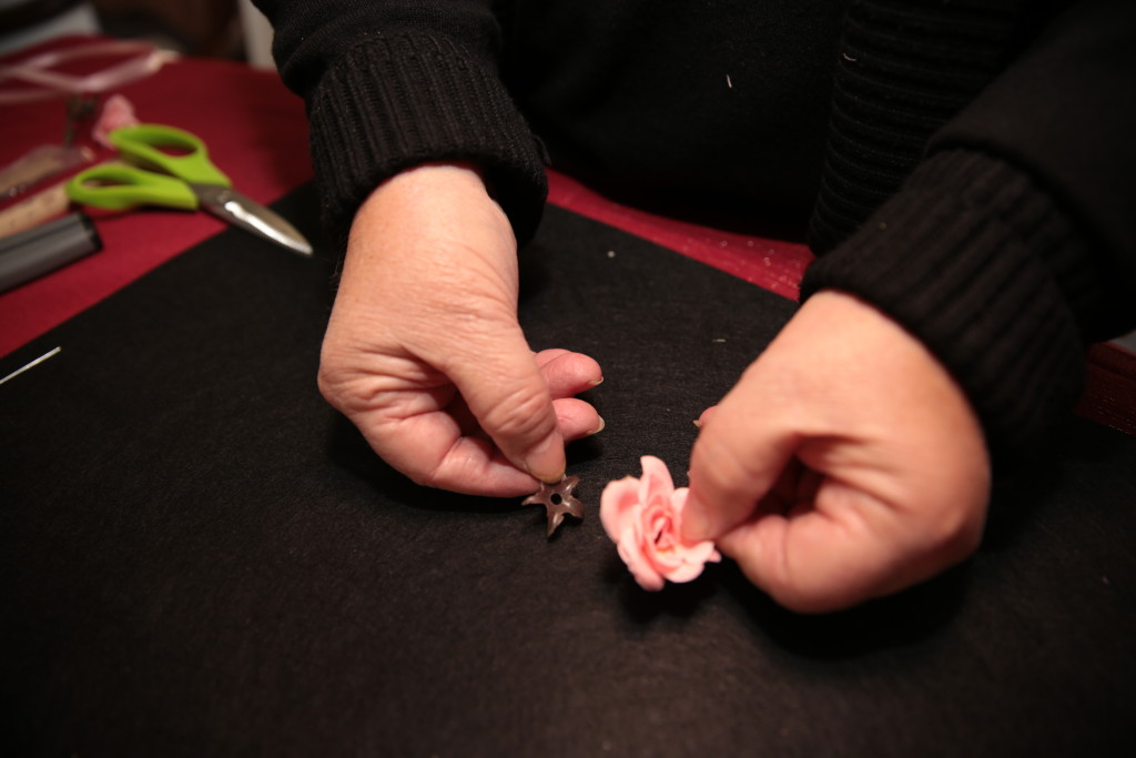 Remove plastic backing from flower.  If desired, the backing can be saved for use later in the project.